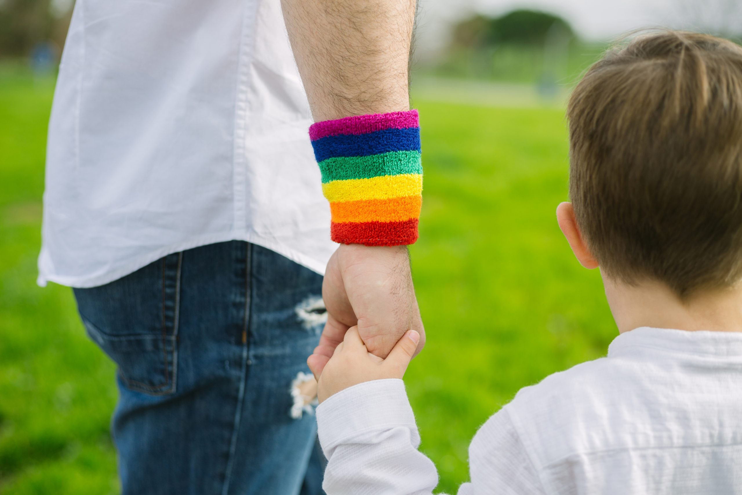 AdobeStock_©_XavierLorenzo_Gay-father-holding-his-son's-hand-in-a-park